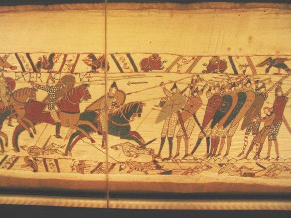A section of the Bayeux Tapestry, artifact from history,  showing Anglo-Saxon warfare.