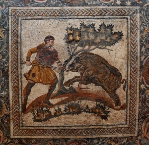 A man hunting down a boar on a 4th century AD Roman mosaic